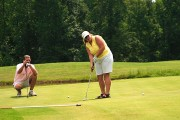 a golf putting lesson on a golf course