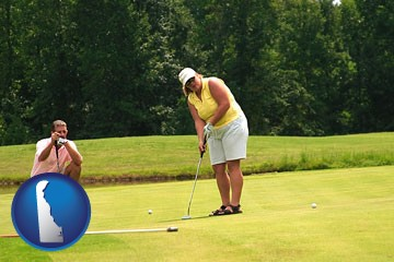 a golf putting lesson on a golf course - with Delaware icon