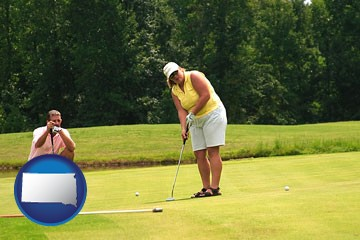 a golf putting lesson on a golf course - with South Dakota icon